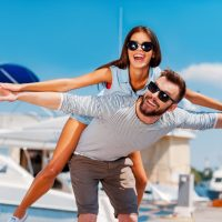 Man and woman pretending to fly after drinking an energy drink